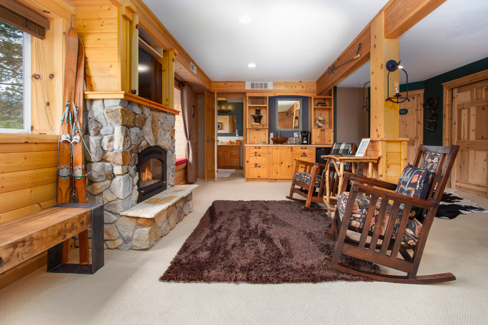 leavenworth wa vacation rental on river - living room with fireplace, rockers, and view.